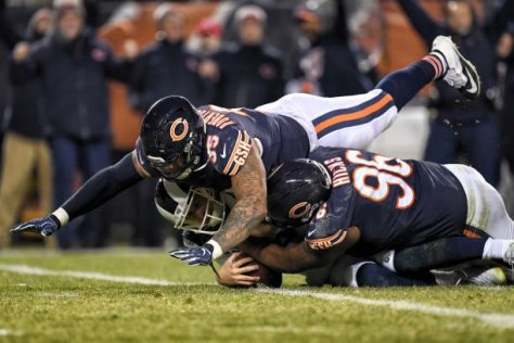 Bears defensive end Roy Robertson-Harris (95) and Chicago Bears defensive end Akiem Hicks (96) sack Los Angeles Rams quarterback Jared Goff (16) in action during an NFL game between the Los Angeles Rams and the Chicago Bears on December 09, 2018 at Soldier Field in Chicago, IL